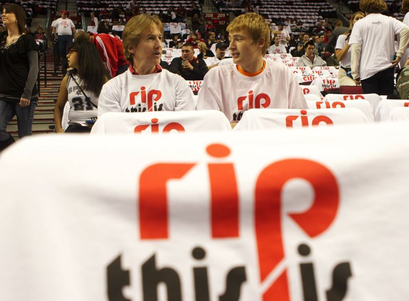by: TRIBUNE PHOTO: JAIME VALDEZ - Tom Sheridan (left) and his son Dan, of Tualatin, sit in Moda Center on Saturday night, sporting their Rip City shirts before the Trail Blazers' home opener against San Antonio.