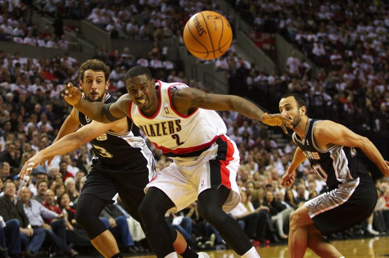 Blazers guard Wesley Matthews has the ball knocked out of his hands by San Antonio's Marco Belinelli (left), as Spurs guard Manu Ginobili closes in on the duo.