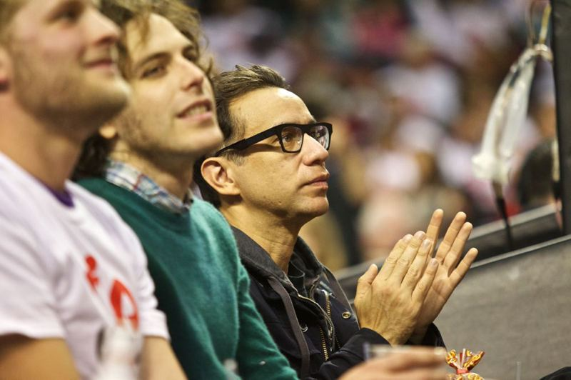 Fred Armisen (right), co-creator, co-writer and co-star of the hit TV show, 'Portlandia,' takes in the Trail Blazers' home-opener against San Antonio Spurs.