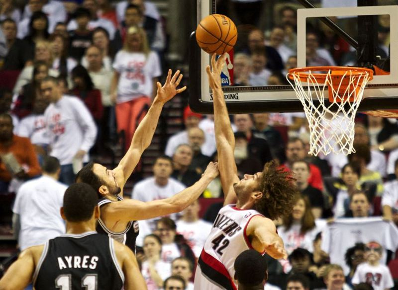 Blazers center Robin Lopez gets his fingertips on an inside shot by San Antonio's Manu Ginobili.