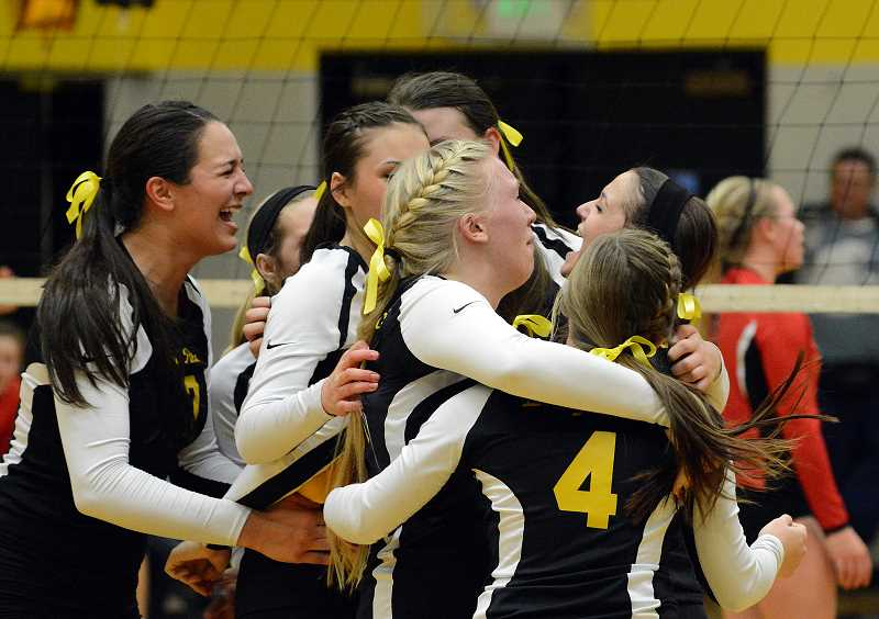 by: JOHN WILLIAM HOWARD - St. Helens teammates meet in the middle of the court to celebrate, seconds after pulling off a miraculous 19-17 win in the 5th set. It was just their second time playing in a fifth set all season, and their first victory.
