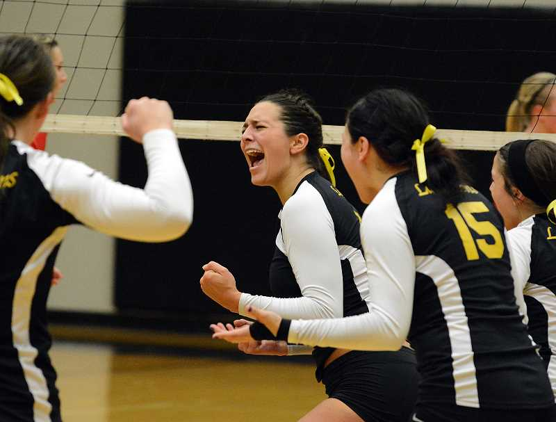 by: JOHN WILLIAM HOWARD - Senior hitter Gabby Susee reacts to a kill in the fifth set.