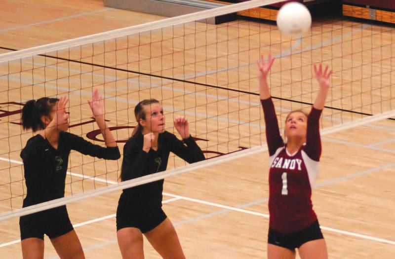 by: SANDY POST: PARKER LEE - Sandys McKenzie Nolin puts a set in play last week vs. Pendleton.