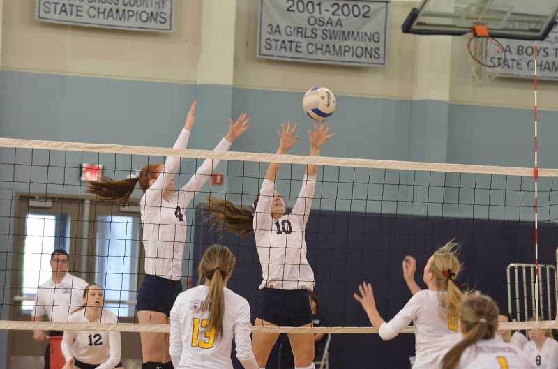 by: JEFF GOODMAN - Wilsonville juniors Kyra Austin (4) and Lexy Thompson form a block Nov. 2 against Crescent Valley in the first round of the Class 5A playoffs. The Wildcats prevailed in a five-set thriller at home.