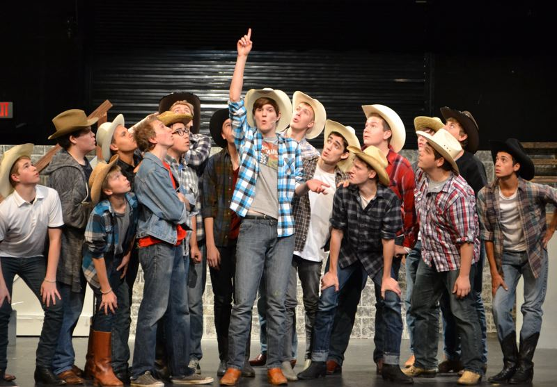 by: SUBMITTED PHOTO - Willard (Zac Burgess), above center, explains the important things his mother has taught him to Ren (Nicholas Hoback) and the boys in 'Footloose.'