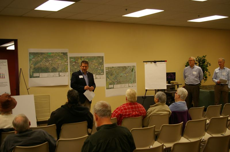 by: PHOTO BY: BRAD ALBERT/CITY OF MILWAUKIE - Mayor Jeremy Ferguson opens a briefing last Wednesday at the Milwaukie Center with (from left) Jim Cox, ODOT project manager, and Dave Simmons of CH2M Hill. There were lots of questions afterward from 25 meeting participants.