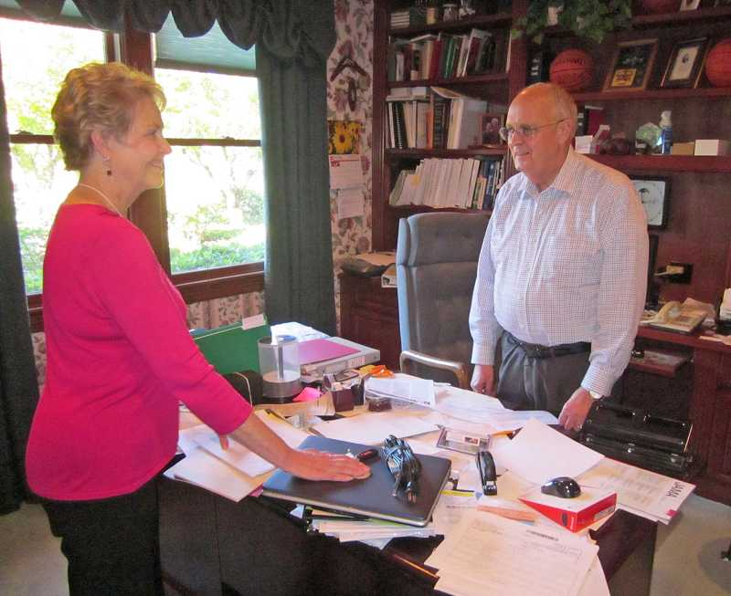 by: BARBARA SHERMAN  - Ken Stevens, shown with his wife Peggy in his home office, works three days a week as a radiation oncologist treating patients at Oregon Health & Science University and Tuality Medical Center.