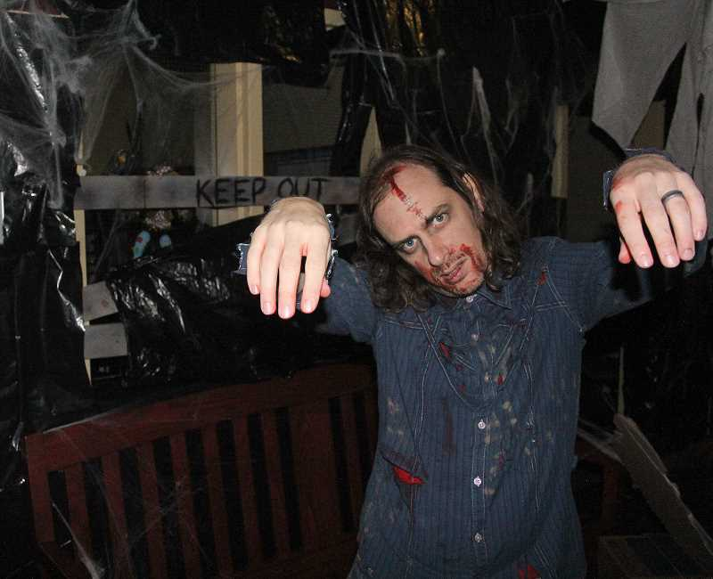 by: JEFF MCDONALD  - Paco Hadley played the role of a zombie at Woodburn Chemeketa Community College's Haunted House.