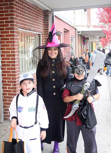 by: JEFF MCDONALD - An astronaut, a witch and a Viking stood tall for Halloween on the streets of downtown Woodburn last week.