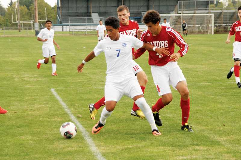 by: PHIL HAWKINS - Woodburn sophomore Eric Diaz and the rest of the Bulldog soccer team will have homefield advantage throughout the playoffs, starting with the teams Tuesday game scheduled against the Sherwood Spartans.