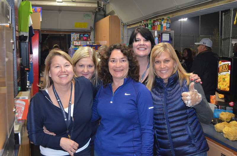 by: JEFF GOODMAN - From left, Margie Shinn, Krista Kays, Delaine Barnes, Jennifer White and Karen Klassy work concessions during the WHS football game against Eagle Point on Nov. 1.