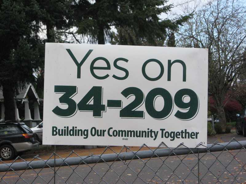 by: RAY PITZ - Here's one of the signs seen on the side of an Old Town business last week asking voters to approve the annexation measure.