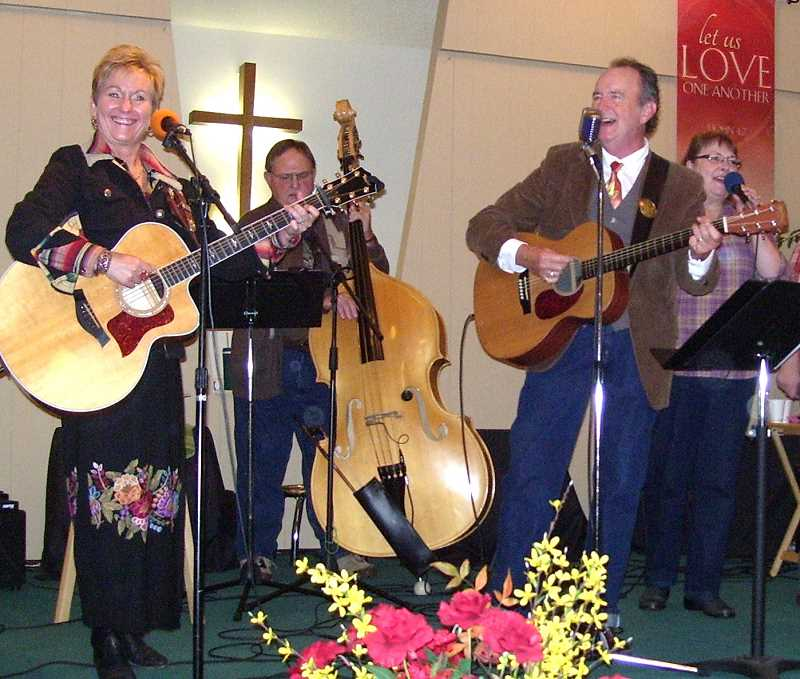 by: CARLA COLEMAN - Joni Harms (left) joined Bill Coleman and the Good News Gospel String Band for the 10th annual Gospel Jamboree at Woodburn Christian Church on Oct. 27.