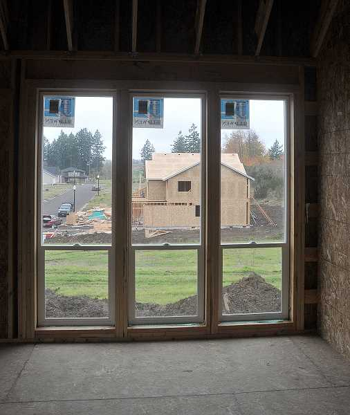 by: GARY ALLEN - Moving in -- The Greens, near the Chehalem Glenn Golf Course, is one of ­several areas in Newberg where new houses are being ­developed. To date in 2013, there have been 33 homes ­started in Newberg, compared to a total of 44 last year.