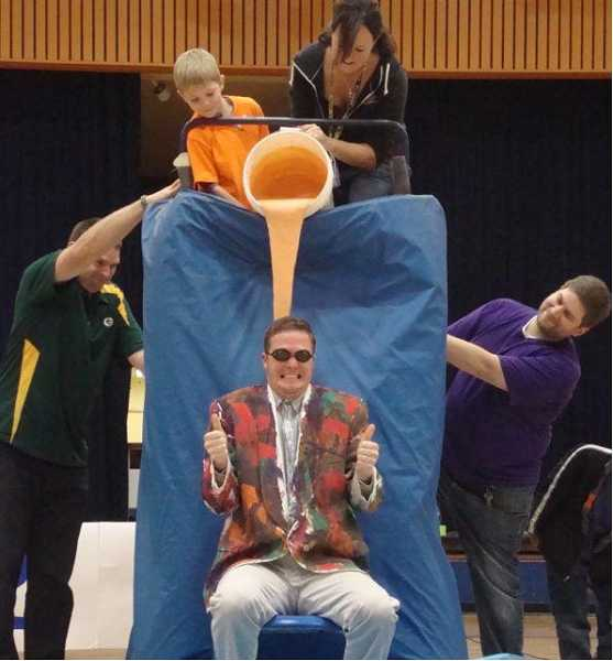 by: SUBMITTED PHOTO - Ninety-One School principal Skylar Rodolph is 'thumbs up' as the sliming process begins. The school exceeded its goal during its annual jog-a-thon, putting Rodolph in the slime chair.