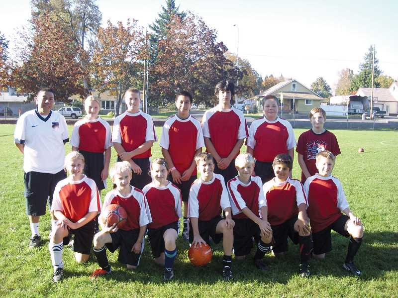 by: SUBMITTED PHOTO - St. Lukes 2013 fall soccer team.