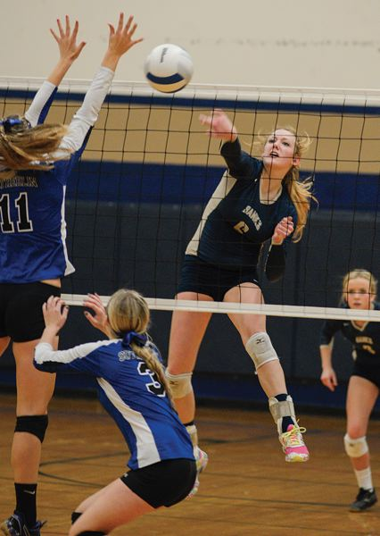 by: NEWS-TIMES PHOTO: CHASE ALLGOOD - Banks sophomore Megan Bunn rips a kill past Sutherlin's Kayce Mock during Saturday's state playoff match.