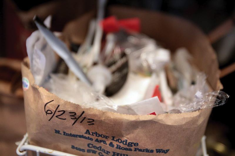 by: TRIBUNE PHOTO: JONATHAN HOUSE - The date on a trash bag reveals that its been the same one used since June 23rd. Betty Shelley only uses four trash bags a year.