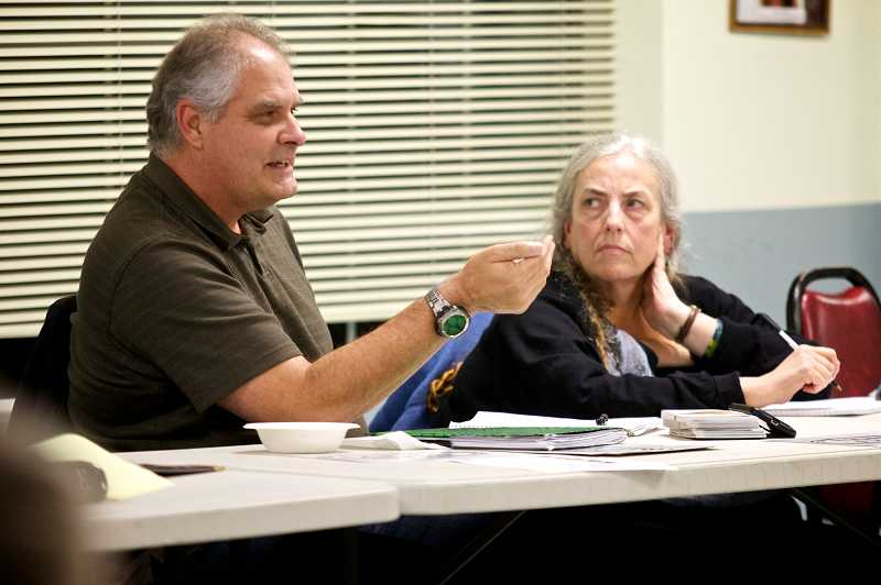 by: JAIME VALDEZ - Karen Crichton, of Lake Oswego, and Steve Bintliff, of Tigard, address the city council at last month's Town Hall. The two founded Tigard First, a local polical group that aims to be the city's 'watchdog.'