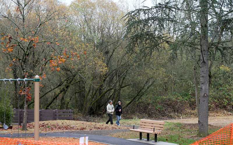 by: TIMES PHOTO: JONATHAN HOUSE - Walkers enjoy the environs of the improved Vista Brook Park off Southwest 88th Avenue.