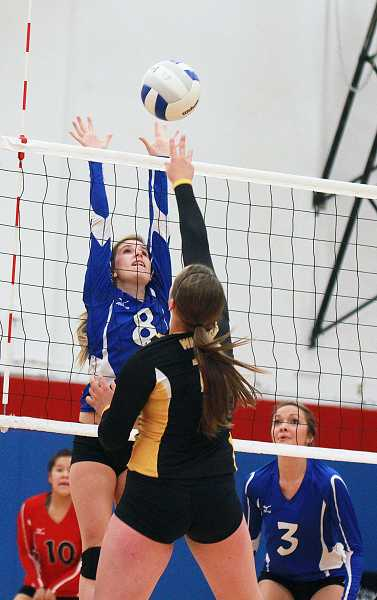 by: BILLY GATES/THE PIONEER - Madras' Karlee Simmons tries to block an attack during Friday night's first-round playoff loss to Philomath.