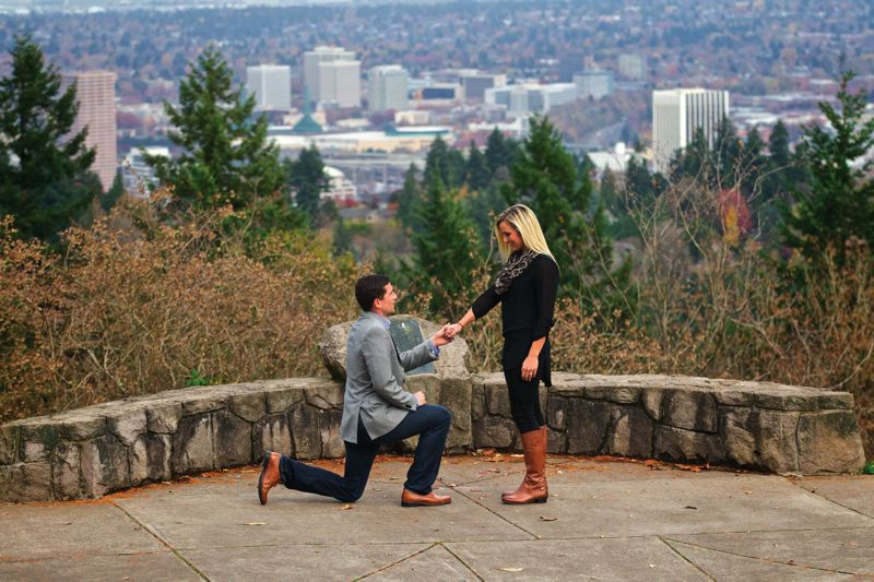 by: TRIBUNE PHOTO: JAIME VALDEZ - Former Portland State quarterback Connor Kavanaugh (left) re-enacts his wedding proposal to former PSU basketball player Lexi Bishop atop Council Crest Park.