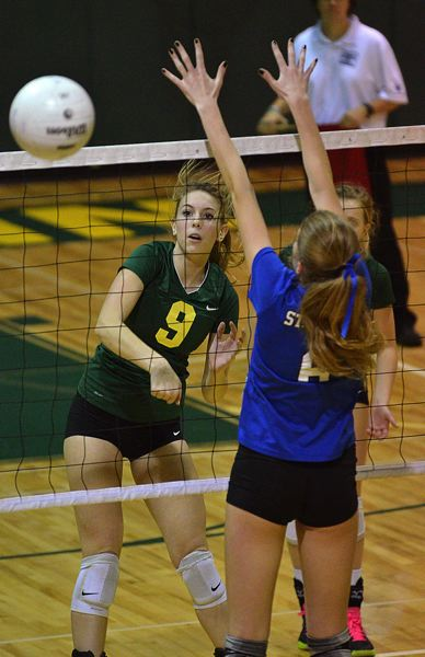 by: VERN UYETAKE - West Linn's Hannah Clarke spikes a ball past a St. Mary's blocker during the Lions' second-round playoff win over the Blues.