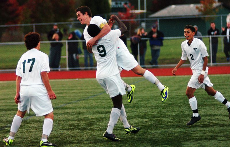 by: DAN BROOD - TIGER GOAL -- Tigard's Mick Whitehead (17), Joseph Lea (9), Sean McManamon and Cesar Conteras (2) celebrate following McManamon's goal in Saturday's state playoff match.