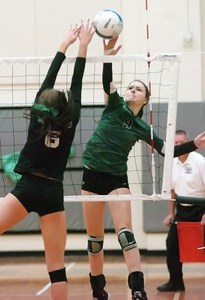 by: DAN BROOD - SMACK -- Tigard sophomore Cassie Erickson hits the ball over the net in last week's playoff match at West Salem.