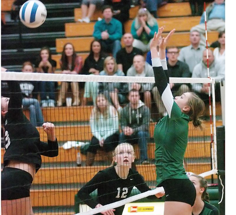 by: DAN BROOD - ABOVE THE NET -- Tigard senior Michelle Simmons (right) goes up for a block during the Tigers' state playoff victory at West Salem.