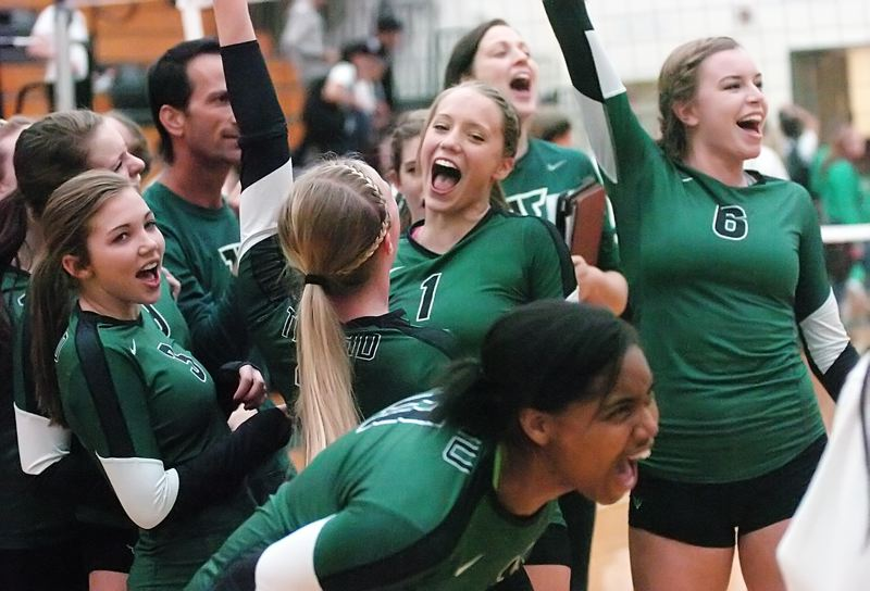 by: DAN BROOD - WE DID IT -- Members of the Tigard High School volleyball team celebrates following their win at West Salem.
