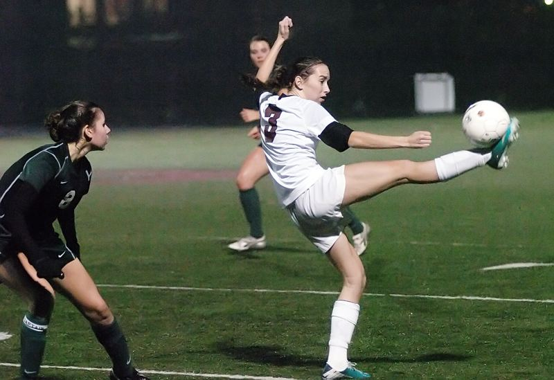 by: DAN BROOD - A LEG UP -- Sherwood senior Mckenzie Cottle (right) gets her foot on the ball.