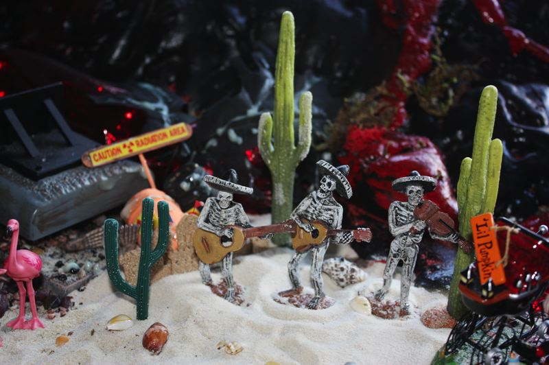 by: HILLSBORO TRIBUNE PHOTOS: DOUG BURKHARDT - A skeleton crew of mariachi band members performs in the sand with cactus alongside; one of the many examples of the intricate detail that has gone into Richard LeFors Halloween display, which now fills his entire two-car garage.