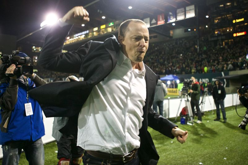 by: TRIBUNE PHOTO: JAIME VALDEZ - Portland Timbers owner Merritt Paulson pumps his fists after Thursday's playoff victory at home over the Seattle Sounders.