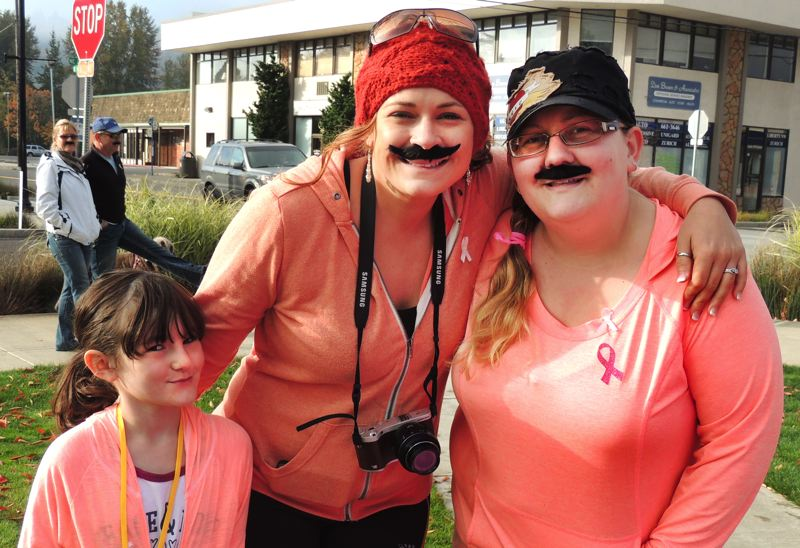 by: CONTRIBUTED PHOTO - Parkers Aunt Crystal, center, and mom, Jessica Butcher, right, supported the 8-year-old's efforts with her first POW Walk, which raised $520 for cancer research.