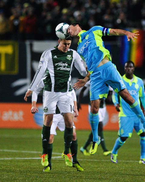 Ben Zemanski (left) challenges Seattle's Brad Evans in the air.