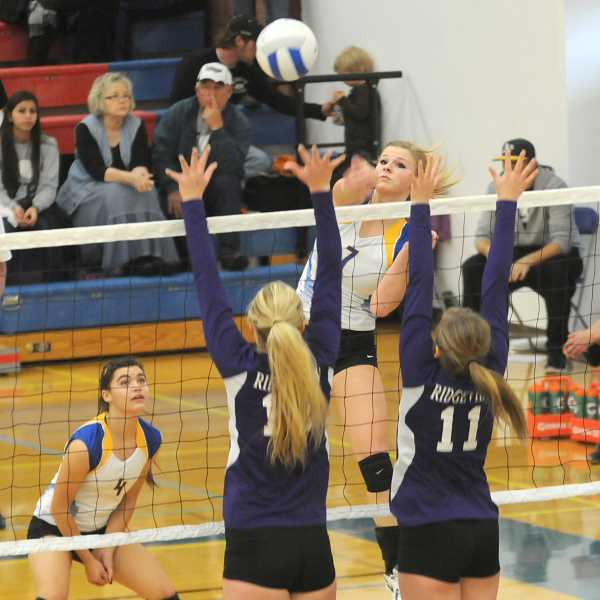 by: LON AUSTIN/CENTRAL OREGONIAN - Hannah Troutman goes up for one of her 25 kills as the Crook County Cowgirls defeated the Ridgeview Ravens in four sets to reach the OSAA Class 4A State Volleyball Tournament semifinals Friday night at Lane Community College in Eugene.