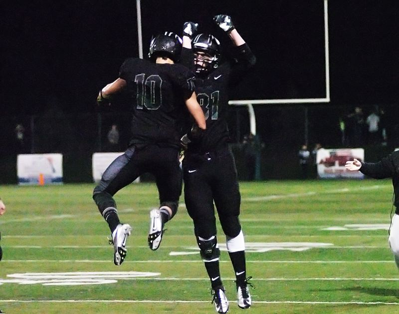 by: DAN BROOD - TD CELEBRATION -- Tigard senior Manu Rasmussen (10) celebrates with senior teammate Cameron Yarnell after scoring a touchdown in the Tigers' 57-29 win over Gresham.