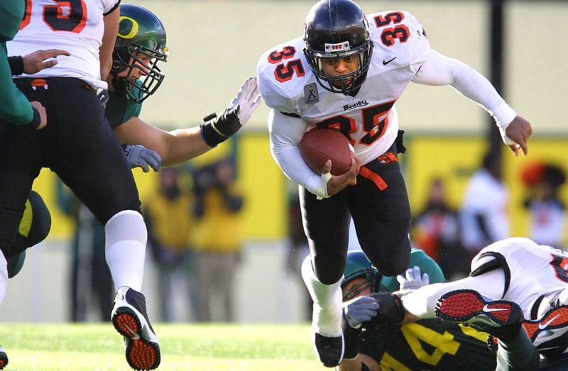 by: TRIBUNE FILE PHOTO: KYLE GREEN - Ken Simonson, who has been voted into the Oregon Sports Hall of Fame, collected 5,004 yards rushing and 59 touchdowns in four seasons for Oregon State.