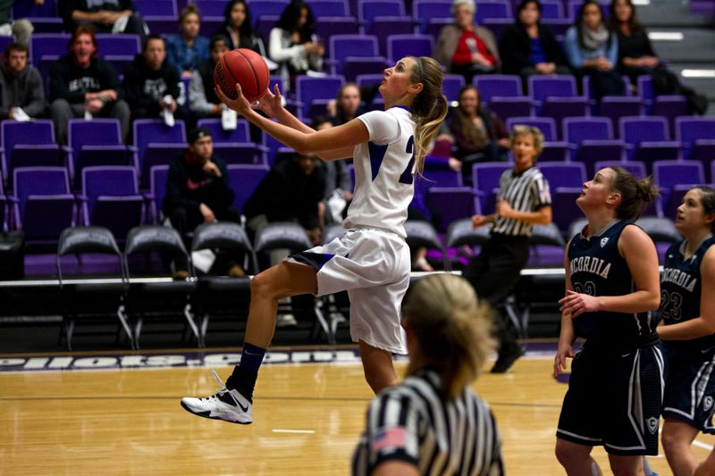 by: COURTESY OF UNIVERSITY OF PORTLAND - Cassandra Brown, going in for a layup in an exhibition victory over Concordia, made her official return from injury and had 13 points and a game-high 12 rebounds as the Portland Pilots beat Eastern Washington 68-65