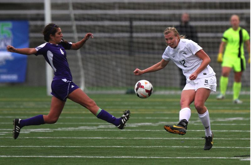 Portland State's Kelsey Henningsen (right) gets off a shot against Weber State.