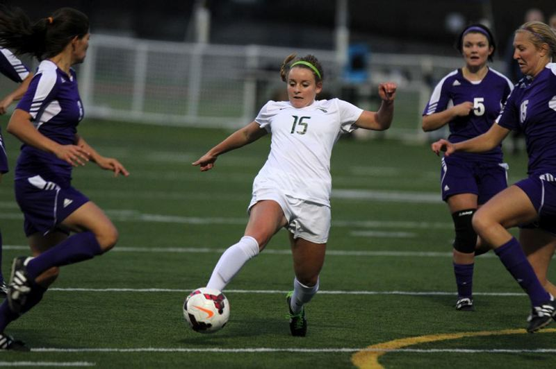 PSU's Emma Cooney gets her foot on a shot between Weber State defenders.