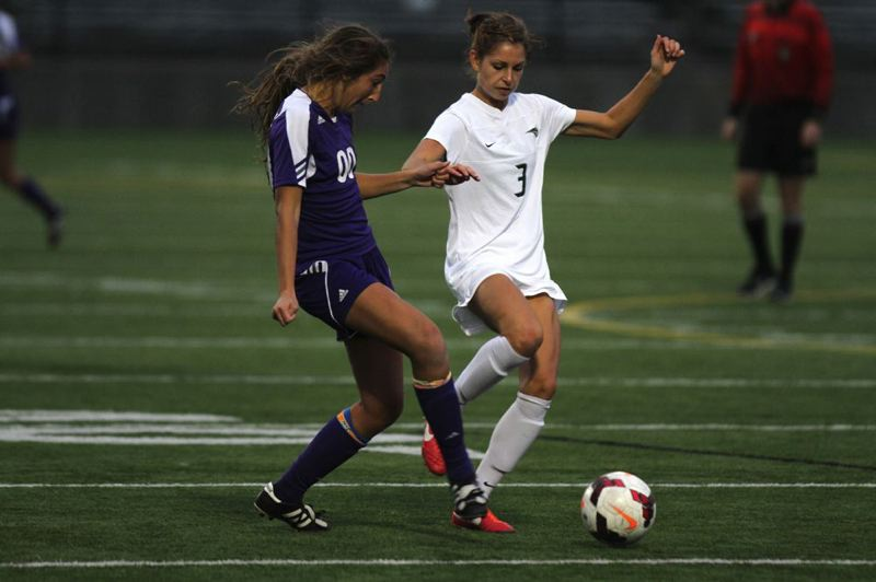 Cori Bianchini (right) of Portland State works against Kellyn Olsen of Weber State.
