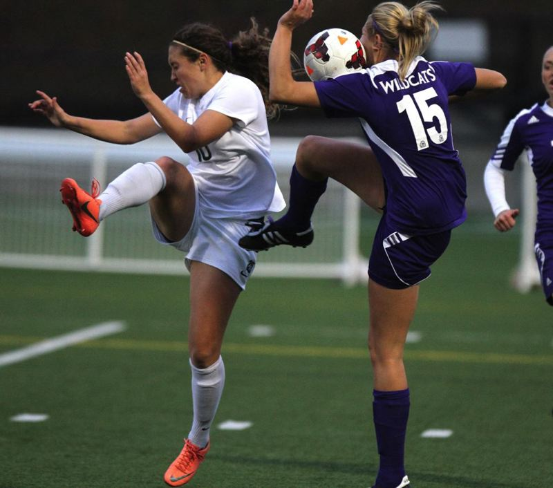 Portland State's Lynsey Gaines (left) and Weber State's Brecken Holbrook go for the ball.