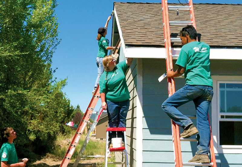 by: PHOTO CONTRIBUTED BY HABITAT FOR HUMANITY - Habitat for Humanity depends on the assistance of volunteers to help low-income families get into affordable homes or upgrade and winterize homes they already own.