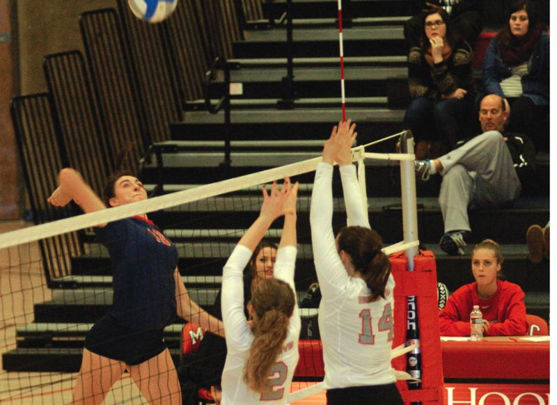by: ESTACADA NEWS: PARKER LEE - Bre Gibbons goes up for an attack at the edge of the net.