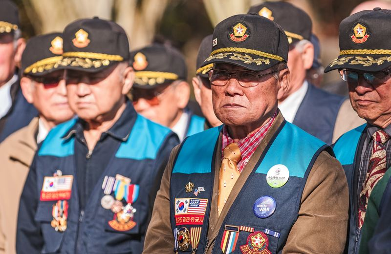 by: SPOKESMAN PHOTO: JOSH KULLA - Korean veterans stood alongside their American counterparts Monday at a Veterans Day ceremony at the Oregon Korean War Memorial in Wilsonville. The memorial was opened in 2000 and stands next to the Wilsonville Visitors Center.