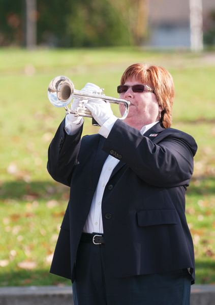 by: SPOKESMAN PHOTO: JOSH KULLA - Local resident Sue Lamb plays Taps Monday in honor of Americas military veterans at a ceremony at the Oregon Korean War Memorial in Wilsonville.