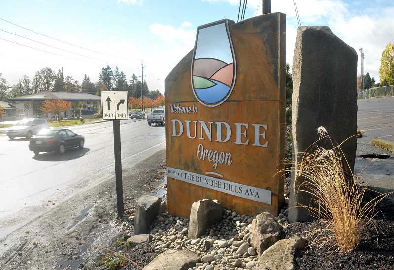 by: GARY ALLEN - Visible re-brand -- The new sign in Dundee, located at First Street and Highway 99W, represents more than a welcome to the city. It's part of a re-branding effort and includes establishing a sense of place based on the sign's graphic.