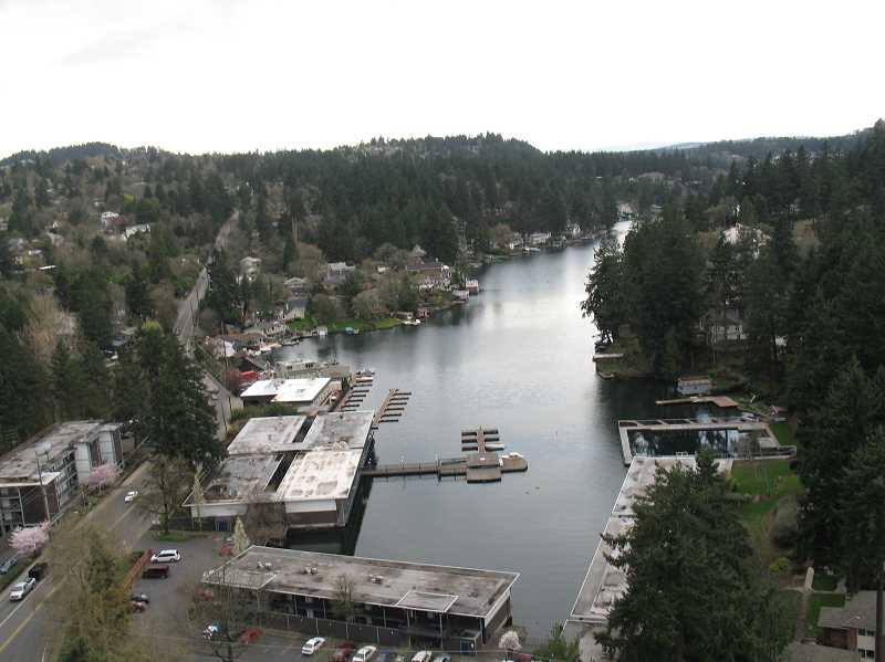 by: REVIEW FILE PHOTO - Oswego Lake, a roughly 400-acre water body maintained by a corporation of homeowners, is at the heart of a dispute involving the city of Lake Oswego, the Lake Oswego Corporation, the state and two fans of recreating on the water.